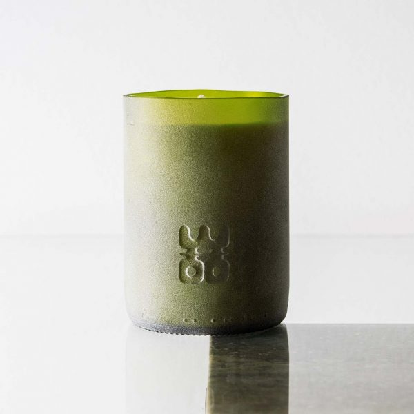 WOO lucky candle matt green extra large on table